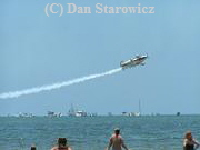 Stunt plane performing near the pier on the North end of Estero Island